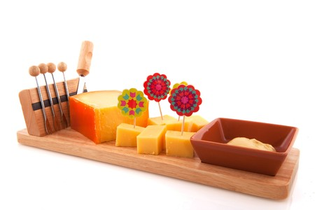 Cheese snack cubes with picks and knife photo