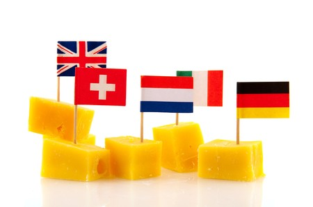 german swiss: Tasty cubes of cheese with European flags as snack Stock Photo