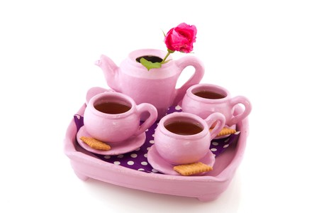 Pink hand craft service with cups of tea isolated over white Stock Photo - 8056327
