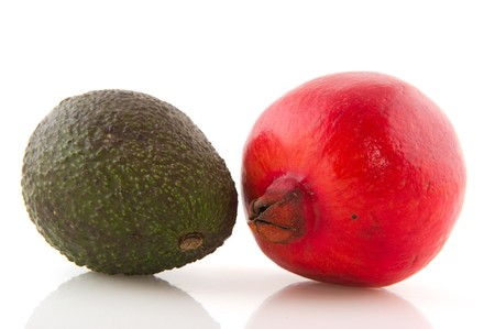 pome: Pome Granate and avocado isolated on white background