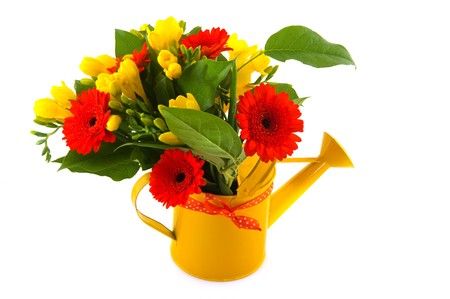 Flower bouquet with orange Gerber and yellow Freesia in watering can photo