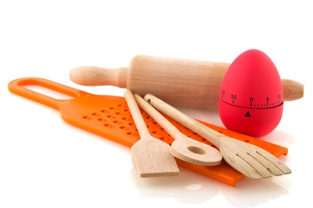 plastic spoon: kitchen utensil with wooden spoons, cooking egg and grater Stock Photo