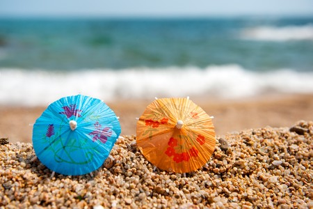 A row with colorful little parasols for shade at the beach
