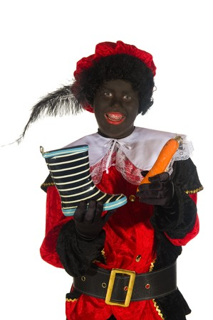 Black Piet has found a shoe with a carrot for the horse of Sinterklaas photo