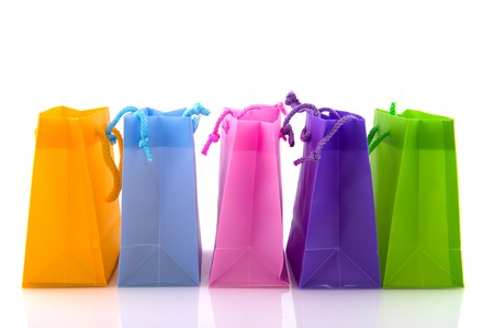 row: Colorful empty shopping bags isolated over white Stock Photo