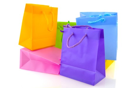 Colorful empty shopping bags isolated over white photo