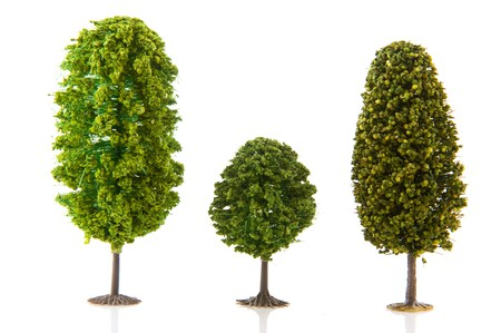 artifical: Three green trees in a row isolated over white background