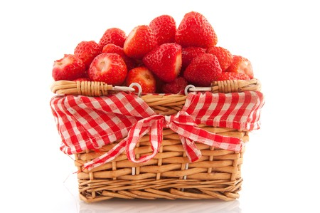 Cheerful basket full with fresh washet strawberries
