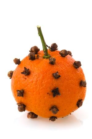 Orange fruit studded with cloves isolated white background Stock Photo - 8315738