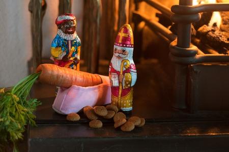 sinterklaas: Sinterklaas shoe with carrot for the horse near the fireplace