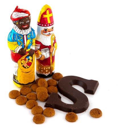 Chocolate Sinterklaas and Black Piet with ginger nuts Stock Photo - 8379412