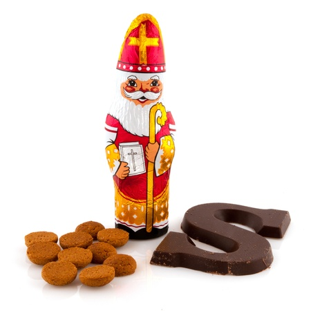Chocolate Sinterklaas with letter and ginger nuts Stock Photo - 8379404