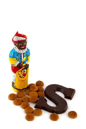 ginger nuts: Chocolate Black Piet with ginger nuts isolated over white