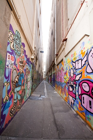 Alley in Melbourne with many graffiti at the wall