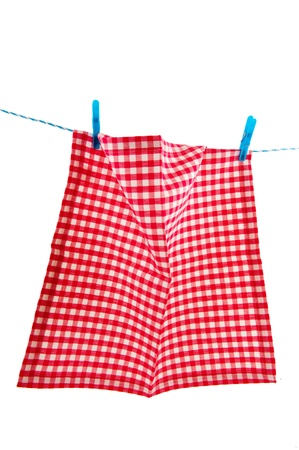 Hanging checkered cloth as laundry at the rope photo