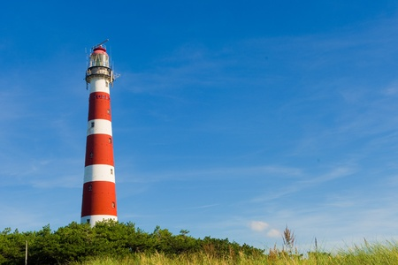 Dutch lighthouse in summer at the island Ameland