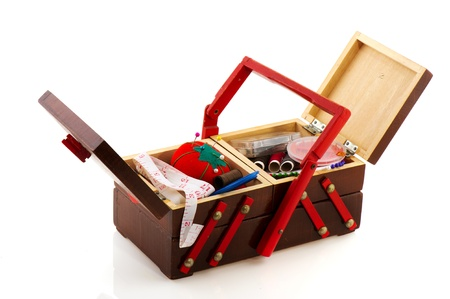 sewing box: Open vintage sewing box filled with all gear Stock Photo