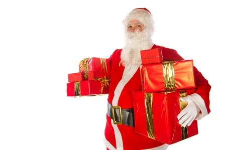 Santa Claus with many Christmas presents on white background photo