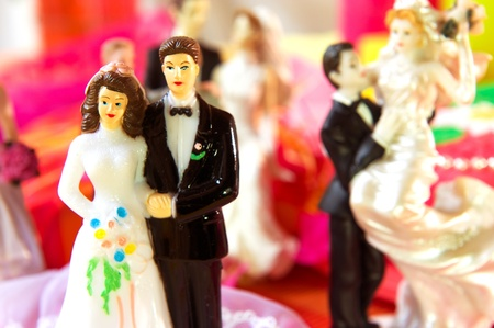 Wedding couple in front of a cake in pink still life photo