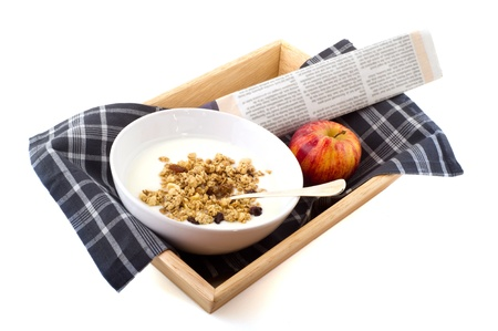 Healthy breakfast with yoghurt and muesli on tray photo
