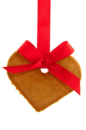 Cookie ginger bread heart with red ribbon photo