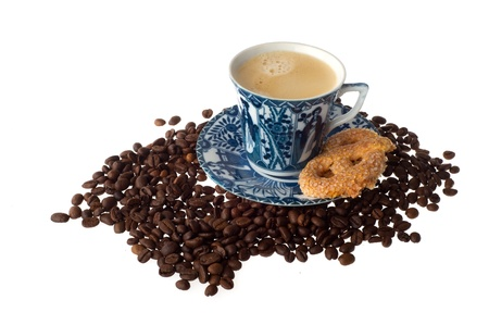 Cup of coffee with cookie and beans photo