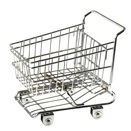Empty metal shopping cart isolated over white background photo