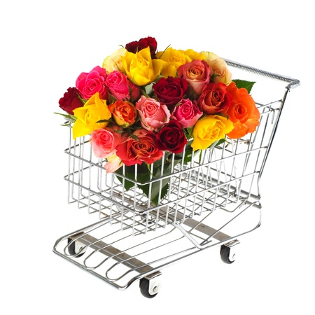 shopping cart with colorful bouquet roses isolated over white photo