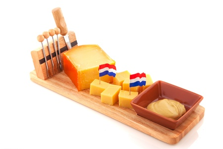 Dutch cheese snack on woioden tray with mustard photo