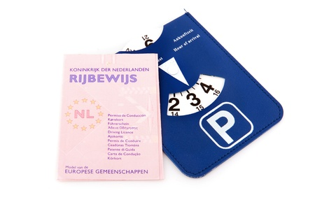 licence: Dutch driver licence and parking card on white background