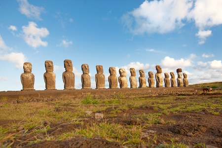Row with old statues at Easter island photo