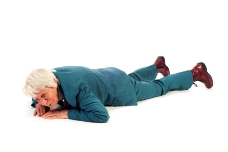 lying down on floor: Old woman is fallen at the floor