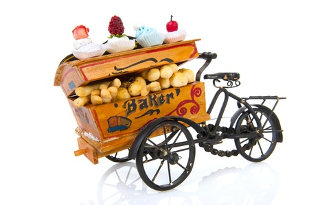 Old vintage bakery car with bread and fancy cakes photo