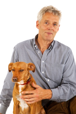 Elderly man with his little brown dog Stock Photo - 8676651