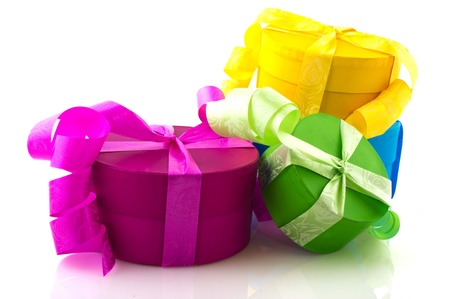 closed ribbon: Colorful presents in pink yellow blue and green