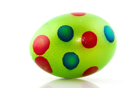 Colorful green dotted easter egg on white background photo
