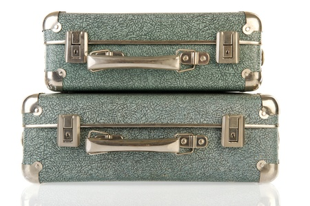 Old vintage carton suitcases isolated over white photo