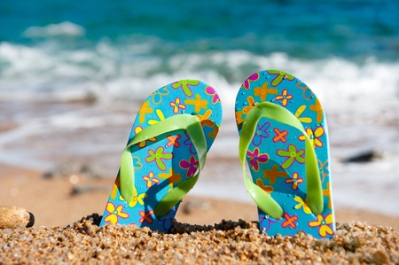 Colorful flip flops at the summer beach photo