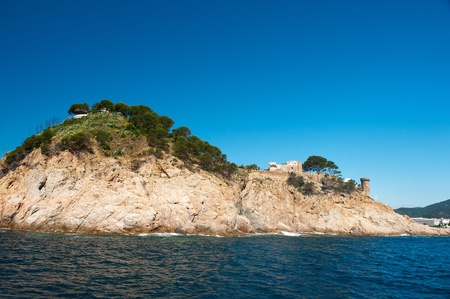 Old ruin of a castle at the Spanish coast photo