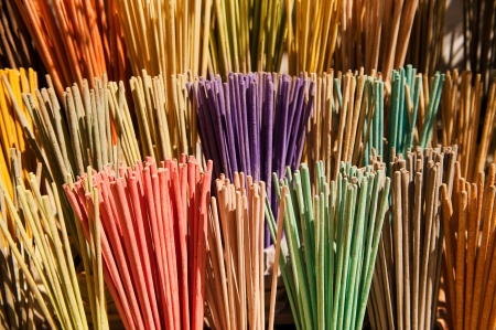 many scented colorful incense sticks in different colors