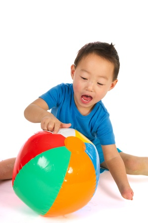 Little Chinese boys with light handicap hand playing with beach ball Stock Photo - 8793546
