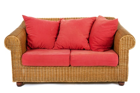 twoseater: Wicker bench with red pillow isolated at white background Stock Photo