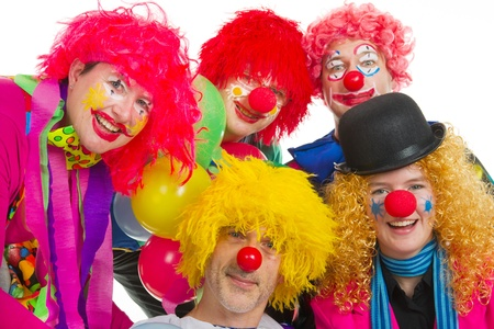 Happy clowns are having a celebration with balloons photo