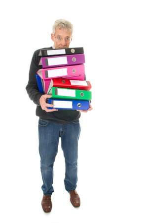 Elderly man in panic while having lots of paper administration photo