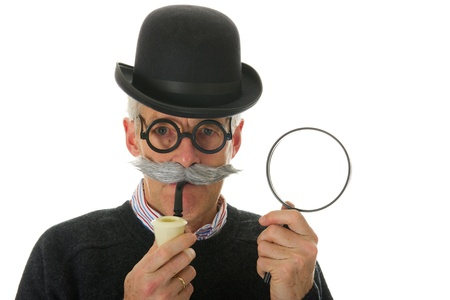 Portrait of a funny inspector with a big magnifier for investigation photo