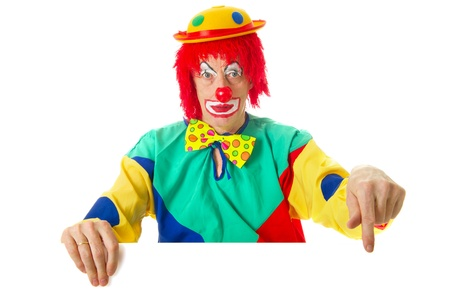 Clown with a white card pointing to youre text photo