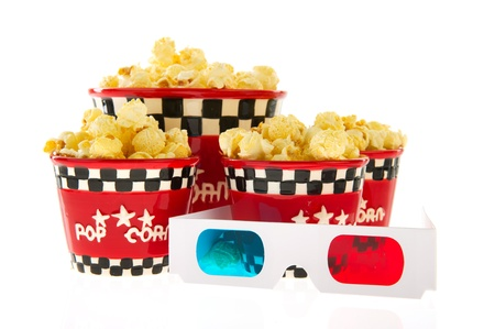 Several boxes full with popcorn and 3D glasses isolated over white photo