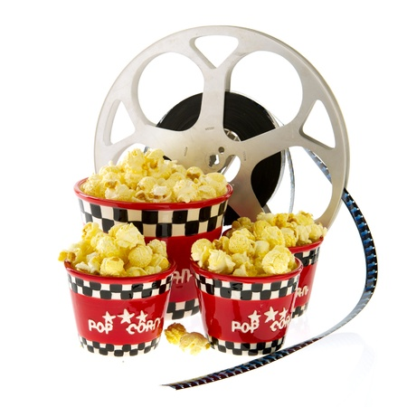 попкорн: Several boxes full with popcorn and movie reel isolated over white