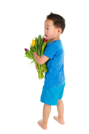 asian tulips: Asian boy with light handicap and a colorful bouquet tulips  Stock Photo