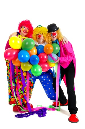 carnival costume: Happy clowns are having a celebration with balloons